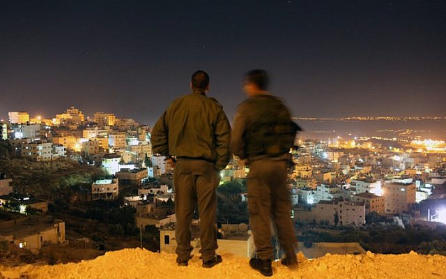 Illustrative photo of Border Policeman overlooking Jerusalem (illustrative photo credit: Kobi Gideon/Flash90)