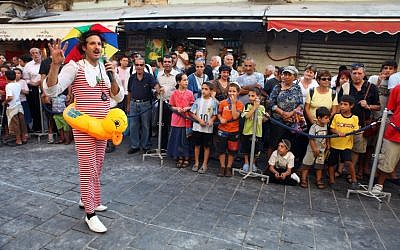 Performances during Balabasta, a summer series of street art at the shuk (photo credit: Abir Sultan/Flash 90)