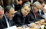 Then-defense minister Ehud Barak (holding pen) looks at then-foreign minister Avigdor Liberman (to his right) at a cabinet meeting led by then-premier Benjamin Netanyahu in 2010. (Amit Shabi/Pool/Flash90)