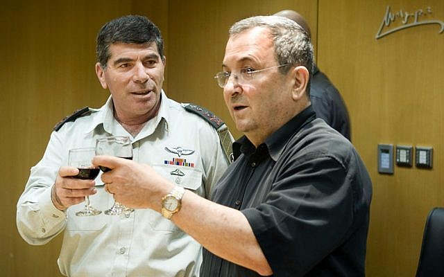 Defense Minister Ehud Barak and then-IDF Chief of Staff Gabi Ashkenazi raising a toast to the Jewish New Year, September 2010 (photo credit: Arielle Yahalom/IDF Spokesperson/Flash90)