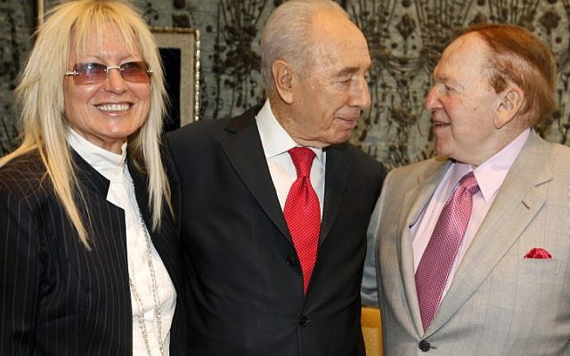 President Shimon Peres with Jewish billionaire businessman Sheldon Adelson (right) and his wife Miriam Ochshorn at the President's house on August 17, 2011. (photo credit: Miriam Alster/Flash90)