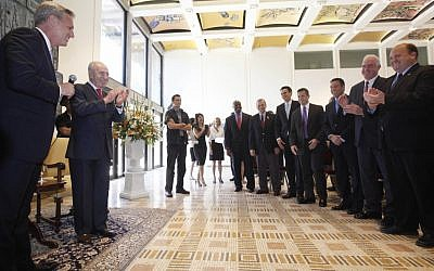 A Congressional delegation singing happy birthday to president Shimon Peres. (photo credit: Miriam Alster/Flash90)