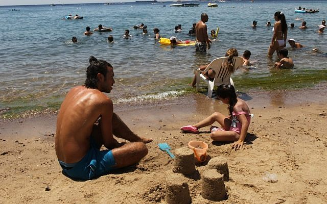 Cooling off at the beach in Eilat. (photo credit: Nati Shohat/Flash90)