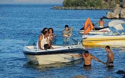 Tourists operate speedboats on the Sea of Galilee (photo credit: Moshe Shai/Flash90)