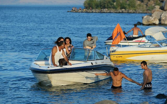 Tourists operate speedboats on the Sea of Galilee (photo credit: Moshe Shai/Flash90)