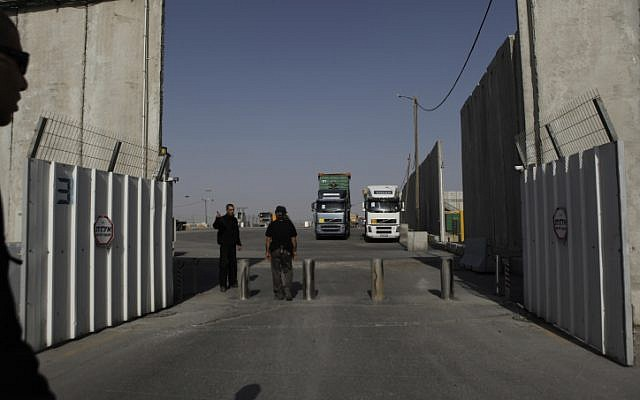 Workers on the Israeli side of the Kerem Shalom border crossing into the Gaza Strip, December 2011 (photo credit Tsafrir Abayov/Flash90)