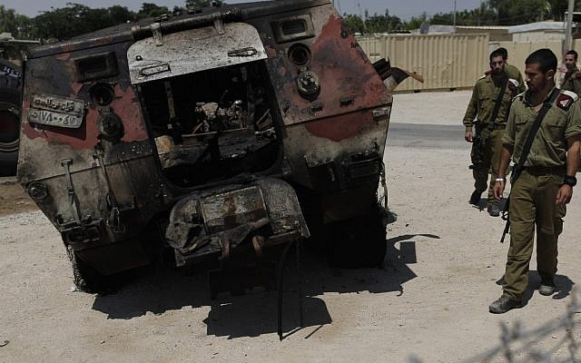 The remains of an Egyptian military vehicle that smashed through the border fence and into Israel (Photo credit: Tsafrir Abayov/ Flash 90)