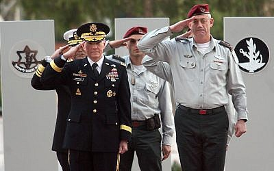 US Chairman of Joint Chiefs of Staff Martin Dempsey, left, and IDF Chief of General Staff Benny Gantz saluting during Dempsey's visit to Israel in January. (photo credit: Gideon Markowicz/Flash90)