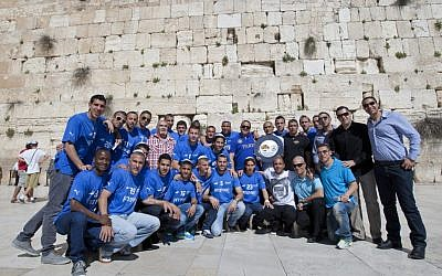 The players of Kiryat Shmona's unexpectedly successful soccer team visit the Western Wall in Jerusalem in April, 2012, after winning the country's premiere league championship. (photo credit: Yonatan Sindel/Flash90)