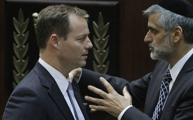 Yohanan Plesner in conversation with Shas Party head Interior Minister Eli Yishai, who served in the army but boycotted the Plesner Committee (photo credit: Miriam Alster/ Flash 90)