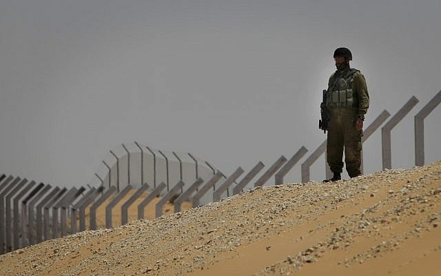 A soldier guarding the border with Egypt after a terror attack in June. (photo credit: Tsafrir Abayov/Flash90)