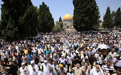Palestinians pray outside the Al-Aqsa Mosque in Jerusalem (photo credit: Sliman Khader/Flash90/File)