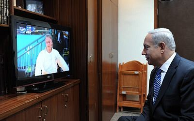 Prime Minister Benjamin Netanyahu watches judoka Alice Schlesinger compete at the Olympics in London on Tuesday, July 31 (photo credit: Amos Ben Gershom/GPO/Flash90)