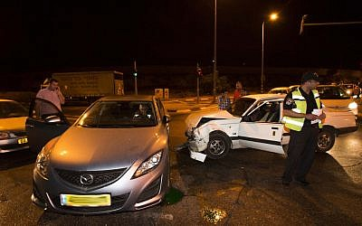 The car of Knesset member Zevulun Orlev after he was involved in a car crash in Jerusalem on Sunday (photo credit: Yonatan Sindel/Flash90)