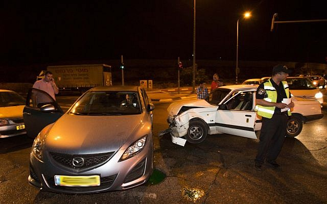 The car of Knesset member Zevulun Orlev after he was involved in a car crash in Jerusalem on Sunday (photo credit: Yonatan Sindel/Flash90)