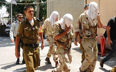 Soldiers of the Kfir Brigade, suspected of abuse, are led to military court in Jaffa, August 5 (photo credit: Yossi Zeliger/Flash90)