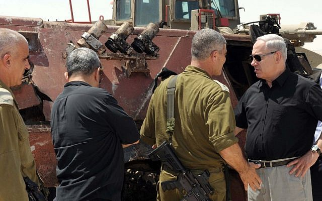 Prime Minister Benjamin Netanyahu, Chief of Staff Lt.-Gen. Benny Gantz, and Defense Minister Ehud Barak at Kerem Shalom on Monday. (photo credit: Avi Ohayon/GPO/Flash90)