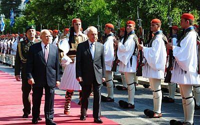 Shimon Peres in Greece Monday. (photo credit: Moshe Milner/GPO/Flash90)