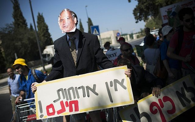 An protesters dressed as Benjamin Netanyahu protesting the high cost of living in Jerusalem Monday. (photo credit: Yonatan Sindel/Flash90)