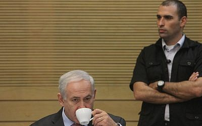Bibi Netanyahu enjoys a rare quiet moment during the Knesset's meeting to review the state comptroller's report on the Carmel fire disaster (photo credit: Miriam Alster/FLASH90)