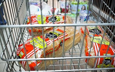 White bread in a shopping cart. hope they took out a loan for all that. (photo credit: Noam Moskowitz/Flash90)