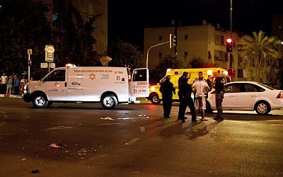Police and medical personnel at the scene of the hit-and-run accident that killed three pedestrians in Netanya Friday night (photo credit: Omer Messinger/Flash90)