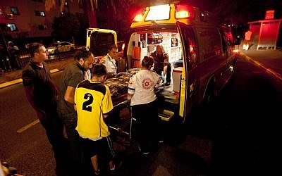 Paramedics at the scene of the hit and run in Netanya Friday night. (photo credit: Omer Messinger/Flash90)