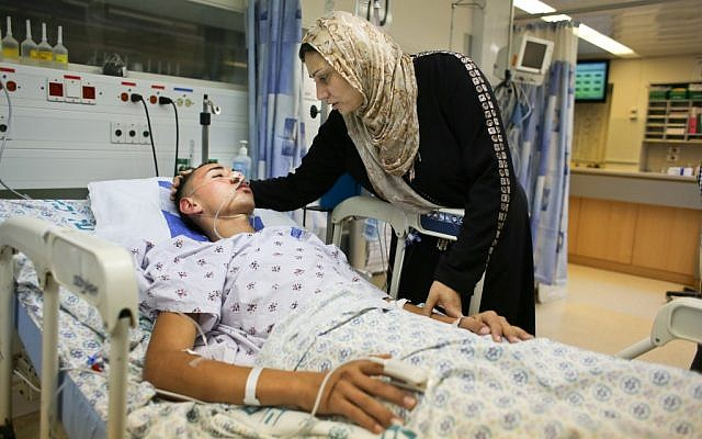 17-year-old Jamal Julani is visited by his mother at Hadassah Ein Kerem Hospital after being attacked by Jewish youths in downtown Jerusalem. (photo credit: Oren Nahshon/Flash90)