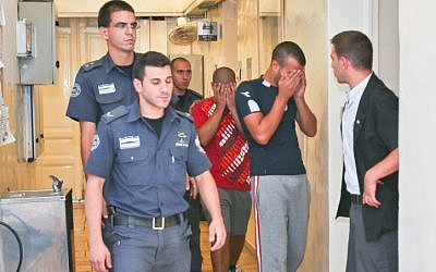 Police escorting suspects in the beating to court on Tuesday (photo credit: Oren Nahshon/Flash90)