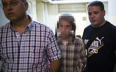 One of the suspected fire bombers in court, August 27 (photo credit: Yonatan Sindel/Flash90)