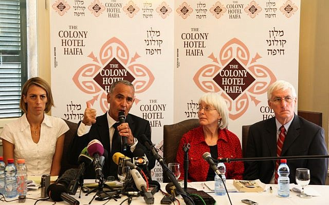 Hussein Abu Hussein, surrounded by Rachel Corrie's family, speaking to reporters Tuesday. (photo credit: Avishag Shaar Yashuv/Flash90)