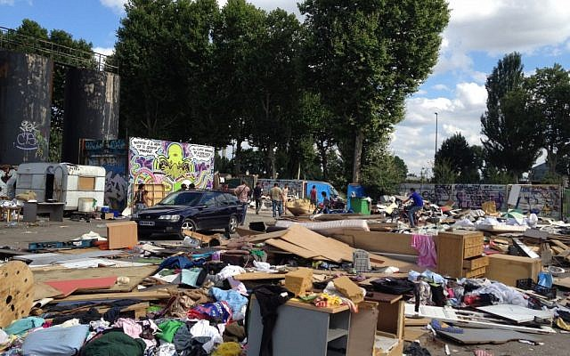 This is a Friday Aug. 10, 2012. file photo of a Roma encampment is set up near a highway in Clamart, west of Paris, Police officers on Thursday shut down encampments used by Roma or Gypsies, in Paris and in the northern city of Villeneuve d'Ascq. (Photo credit: AP/Michel Euler, File)