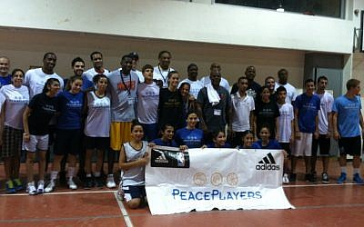 Basketball brings former NBA players together with Jewish and Arab youth.