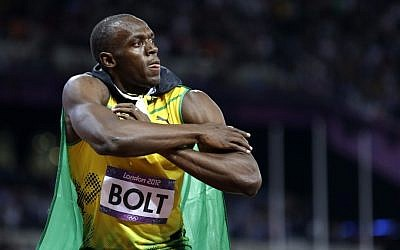 Jamaica's Usain Bolt reacts to his win in the men's 100-meter final at the Olympic Games on Sunday (photo credit: AP/Anja Niedringhaus)