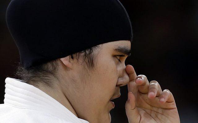 Saudi Arabia's Wojdan Shahrkani reacts during the women's 78-kg judo competition against Puerto Rico's Melissa Mojica at the 2012 Summer Olympics, Friday, Aug. 3 (photo credit: AP/Paul Sancya)