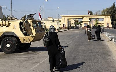 Palestinians walk toward the Rafah border crossing August 10 (photo credit: AP Photo)