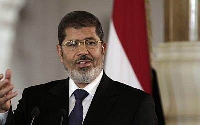 Egyptian President Mohammed Morsi speaks to reporters. (photo credit: AP)