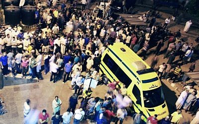 Egyptians stand outside a hospital in El-Arish, northern Sinai, following the terrorist attack on August 5, 2012  (photo credit: AP photo)
