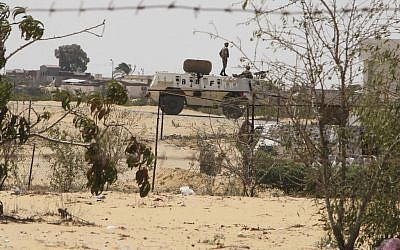 Egyptian border guards patrol near the border with Israel in Rafah, Egypt, earlier this month (photo credit: Ahmed Gomaa/AP)
