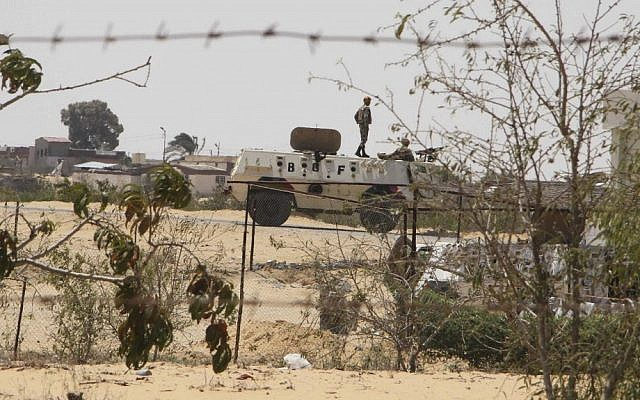 Egyptian guards on patrol in Rafah, near the Egypt-Israel border (photo credit: AP/Ahmed Gomaa)
