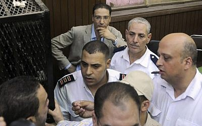 Islam Afifi, the chief editor of el-Dustour newspaper, center, attends a court hearing in Cairo, Egypt. (photo credit: AP)