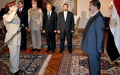 Egyptian President Mohammed Morsi, right, swears in newly-appointed Minister of Defense, Lt. Gen. Abdel-Fattah el-Sissi, in Cairo on Sunday, Aug. 12, 2012. (photo credit: Egyptian Presidency/AP)