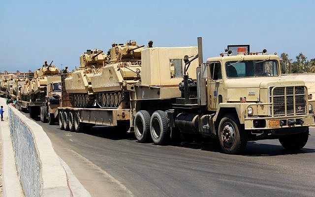 Illustrative photo of Egyptian army trucks carrying military tanks in the northern Sinai Peninsula last year. (photo credit: AP/File)