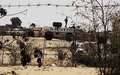 Egyptian border guards patrol near the border with Israel in Rafah, Egypt (photo credit: AP/Ahmed Gomaa, File)
