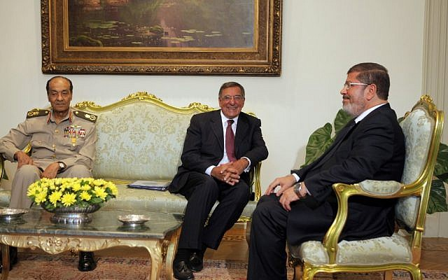 Leon Panetta (center) met with Fieldmarshal Tantawi and President Mohammed Morsi in Cairo, in July (photo credit: AP/Amr Nabil)