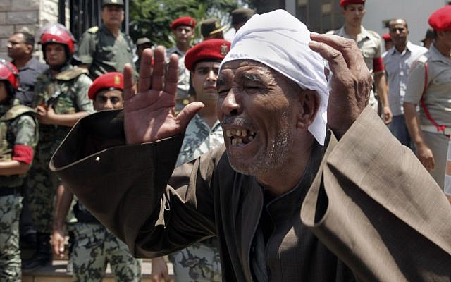An Egyptian man mourns during the funeral of 16 slain soldiers in Cairo Tuesday (photo credit: AP Photo/Thomas Hartwell)
