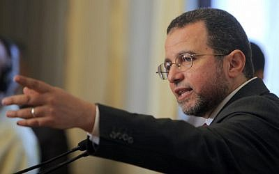 Egypt's new prime minister Hesham Kandil at a press conference in Cairo on Thursday. (photo credit: Amr Nabil/AP)