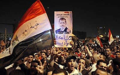 A pro-Morsi demonstration at Cairo's Tahrir Square, August 12 (photo credit: AP/Amr Nabil)