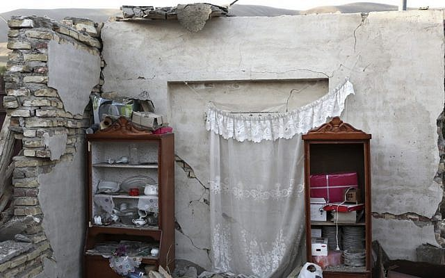 Remains of a building following an earthquake in a village near the city of Varzaqan in northwestern Iran, Monday, Aug. 13 (photo credit: AP/Mehr News Agency, Armin Karami)