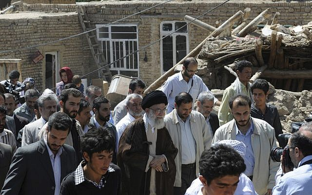 In this photo released by official website of the Iranian supreme leader's office, Iranian supreme leader Ayatollah Ali Khamenei, center, visits a village damaged by an earthquake in northwestern Iran, Thursday, Aug. 16, 2012. (AP Photo/Office of the Supreme Leader)